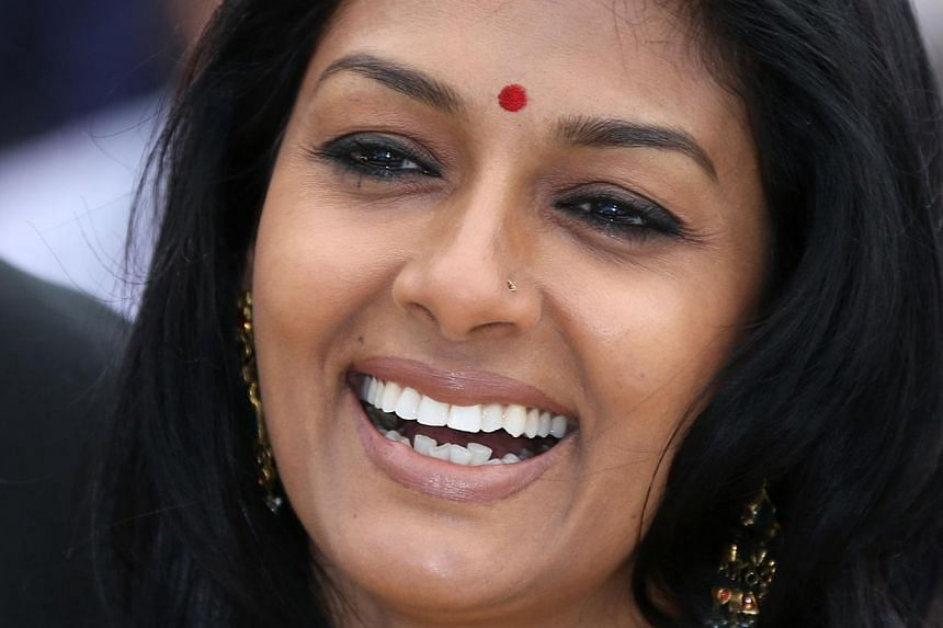 Indian actress and director Nandita Das smiles while posing during a photocall for the Cinefondation and Short Films Jury at the 66th edition of the Cannes Film Festival in Cannes on on May 22, 2013. -- PHOTO: AFP