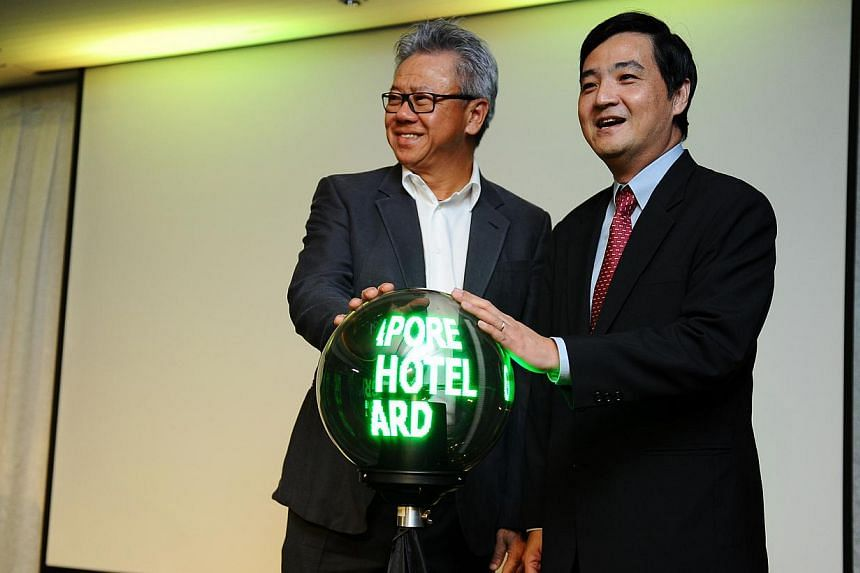 The vice-president of the Singapore Hotel Association,Mr Albert Teo,and Mr Heng Chee How (left), Senior Minister of State, Prime Minister's Office at the launch of the official Singapore Green Hotel Award logo during the Singapore Green H
