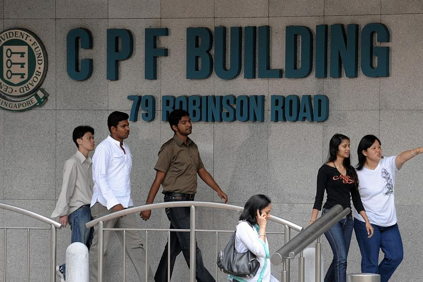 Workers outside CPF Building. CPF members will continue to get a 2.5 per cent interest rate on their on Ordinary Accounts (OA) from Oct 1 to Dec 31 this year. -- ST FILE PHOTO: CAROLINE CHIA