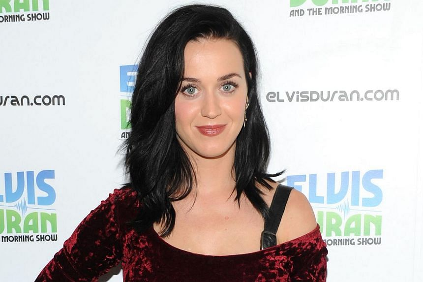 Katy Perry at The Elvis Duran Z100 Morning Show at Z100 Studio on Aug 12, 2013 in New York City. Perry took Mr Tony Abbott to task over his stance on gay marriage, telling the Australian opposition leader she would not vote for him. -- FILE PHOTO: AF
