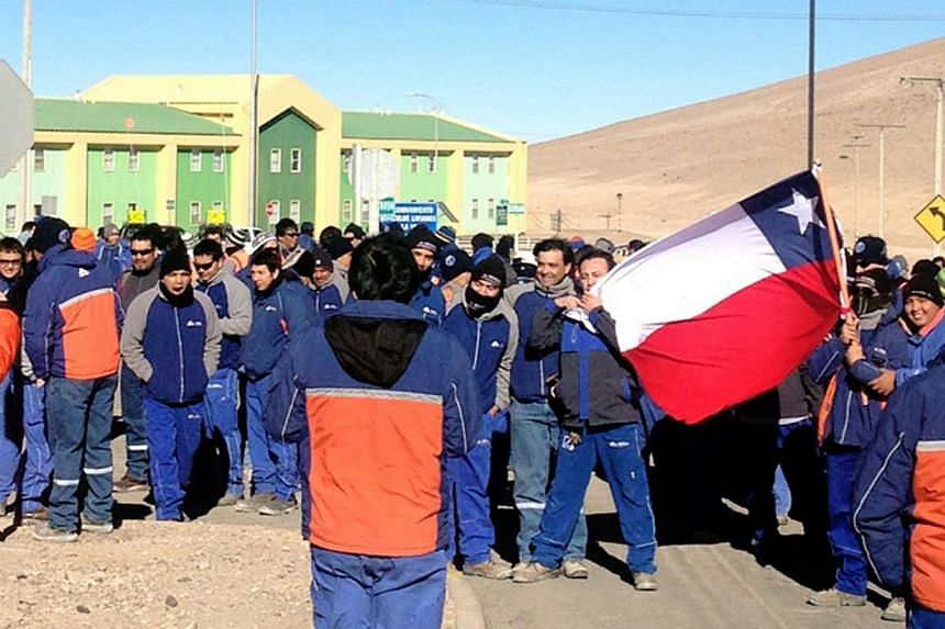 Workers of the Escondida mine --of Australian company BHP Billiton-- on strike protest outside the mine compound on Aug 14, 2013 in Antofagasta, Chile. -- PHOTO: AFP