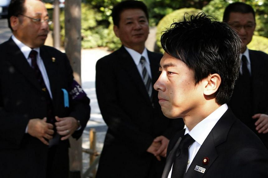 Mr Shinjiro Koizumi, a Japanese lawmaker from the ruling Liberal Democratic Party and son of former Prime Minister Junichiro Koizumi, arrives at the Yasukuni Shrine in Tokyo on Aug 15, 2013, to mark the 68th anniversary of Japan's surrender in World