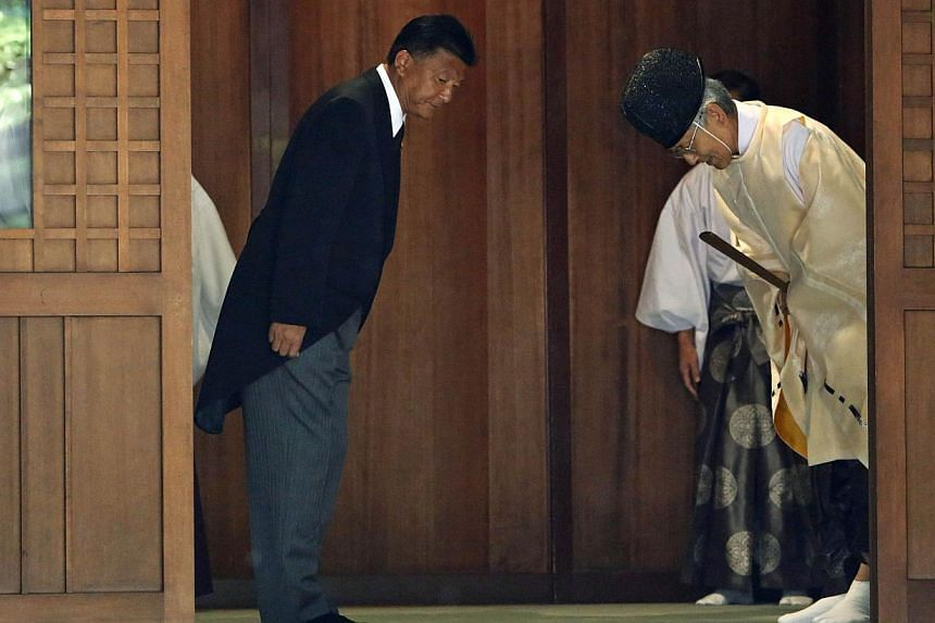 Japan's Internal Affairs and Communications Minister Yoshitaka Shindo leaves after visiting the Yasukuni Shrine in Tokyo on Aug 15, 2013, to mark the 68th anniversary of Japan's defeat in World War Two. -- PHOTO: REUTERS