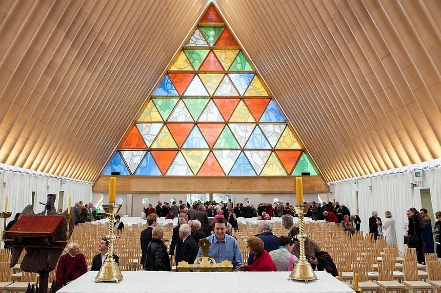This handout picture taken on Aug 4, 2013 and released by photographer Bridgit Anderson on Aug 15, 2013 shows the first service inside the Anglican Church of New Zealand made from cardboard, built in Christchurch to replace the historic Anglican cath