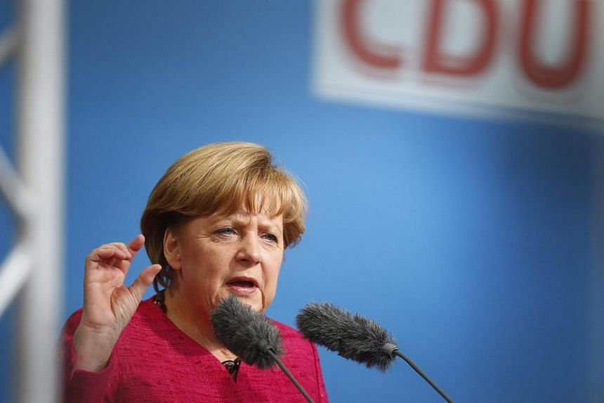 German Chancellor Angela Merkel speaks during a Christian Democratic Union (CDU) election campaign rally in Seligenstadt near Frankfurt on Aug 14, 2013. -- PHOTO: REUTERS