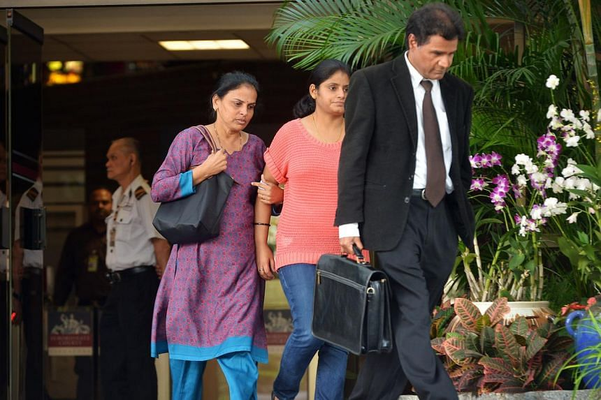 The mother (left) of the deceased Dinesh Raman Chinnaiah leaves the Subordinate Courts on July 19, 2013.The family of the inmate who died in prison in 2010 have written through their lawyer to the Attorney-General Chambers (AGC), seeking for th