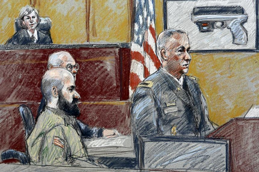 In this Aug 6, 2013 file courtroom sketch, military prosecutor Colonel Steve Henricks, right, speaks as Nidal Malik Hasan, centre, and presiding judge Colonel Tara Osborn look on during Hasan's court-martial on Tuesday, Aug 6, 2013, in Forth Hood, Te