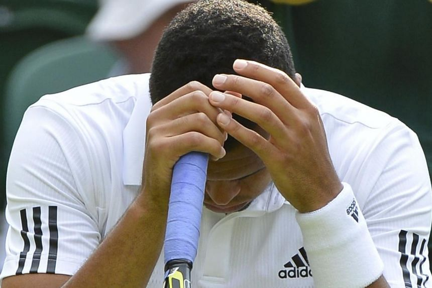 Frenchman Jo-Wilfried Tsonga will not compete at this month's US Open tennis tournament after failing to recover in time from a knee injury. -- FILE PHOTO: REUTERS