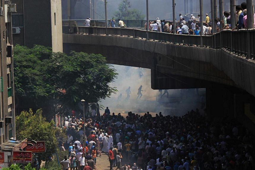 Supporters of Egypt's ousted President Mohamed Mursi clash with security forces in the eastern Nasr City district of Cairo, Egypt, on Aug 14, 2013. Egyptian security forces crushed the protest camps of thousands of supporters of the deposed Islamist