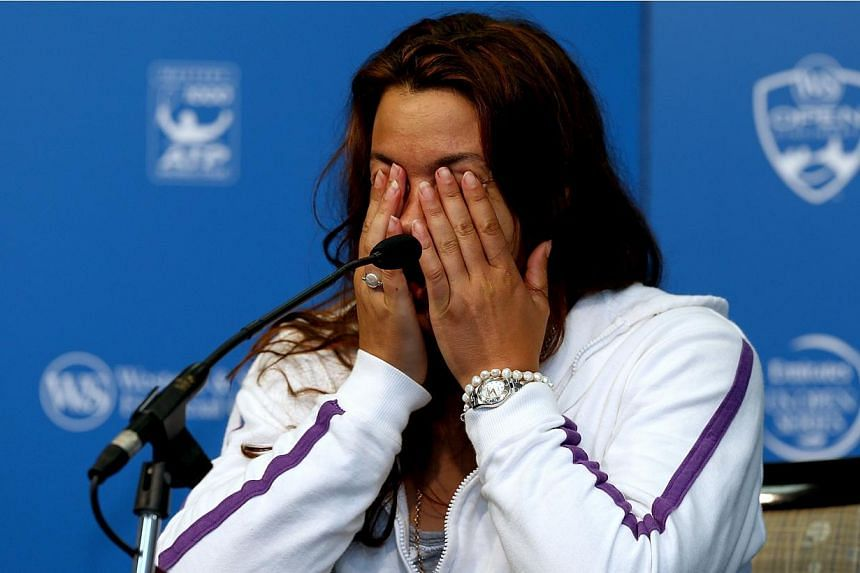 Marion Bartoli of France announces her retirement from professional tennis during the Western & Southern Open on Aug 14, 2013, at Lindner Family Tennis Center in Cincinnati, Ohio. -- PHOTO: AFP