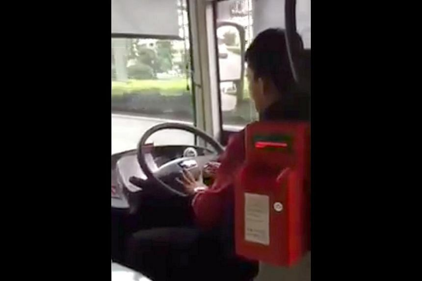 A screenshot from the video on Facebook shows the driver trimming his nails as the bus moves along the expressway. It is understood to have been SMRT service 858 going from Changi Airport to Woodlands.