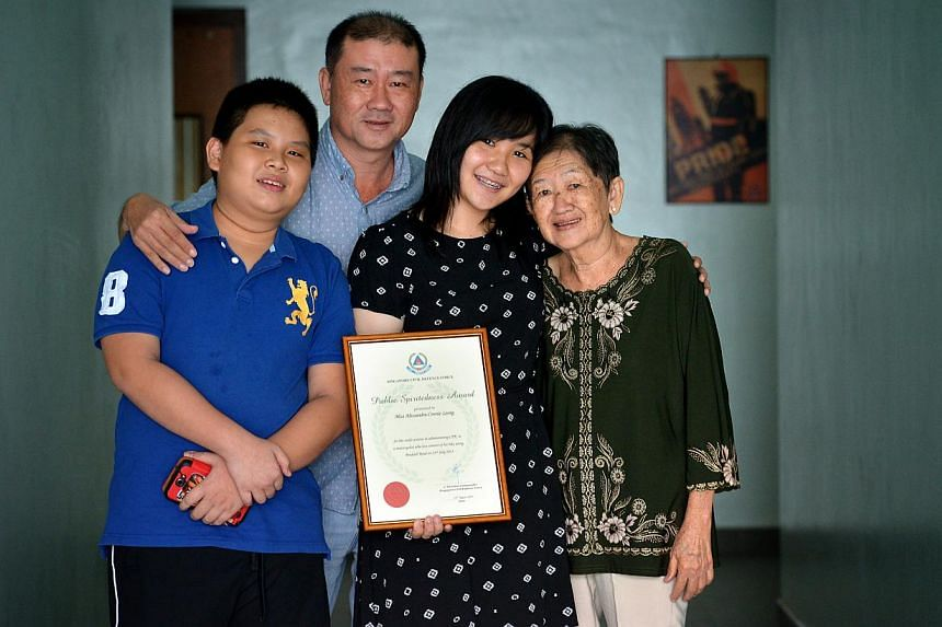 Ms Alessandra Connie Leong (above, second from right), with (from left) brother Ivan, father Leong Fok Chai and grandmother Kwek Kah Ling at the award ceremony. Ms Leong had used CPR to try to save a motorcyclist who had crashed on July23.