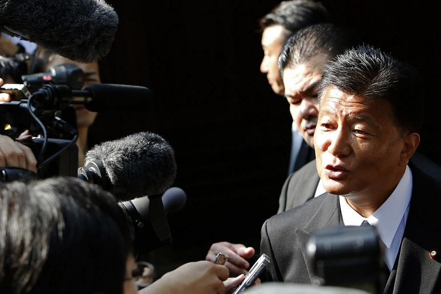 Japan's Internal Affairs and Communications Minister Yoshitaka Shindo speaks to the media after visiting the Yasukuni Shrine in Tokyo August 15, 2013, to mark the 68th anniversary of Japan's defeat in World War Two. -- PHOTO: REUTERS
