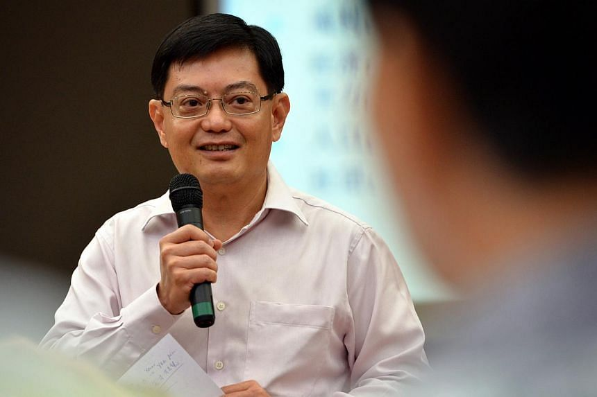 Mr Heng Swee Keat gives his roundup after listening to the presentations at the first Our Singapore Conversation dialogue. -- ST FILE PHOTO: KUA CHEE SIONG