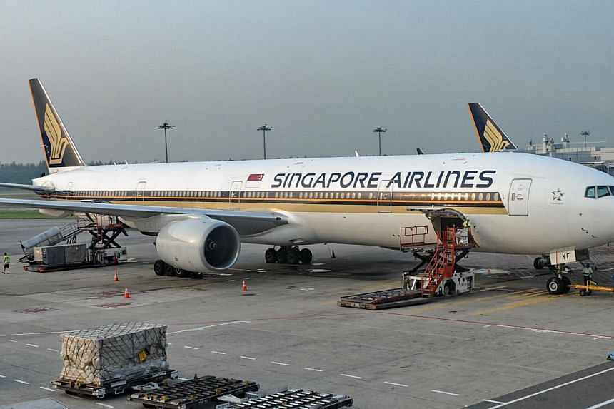 A Singapore Airlines (SIA) Boeing 777-312 is seen parked at the Changi International airport terminal in Singapore on June 28, 2013. Singapore Airlines' passenger load factor in July improved by 0.3 percentage point to 80.8 per cent. -- FILE PHOTO: A