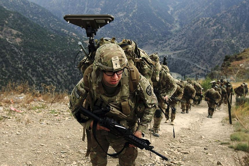 US Army soldiers climb upon arrival to Observation Post Mace from Forward Operating Base Bostick in eastern Afghanistan Naray district, Kunar province near border of Pakistan on Aug 26, 2011. -- FILE PHOTO: REUTERS