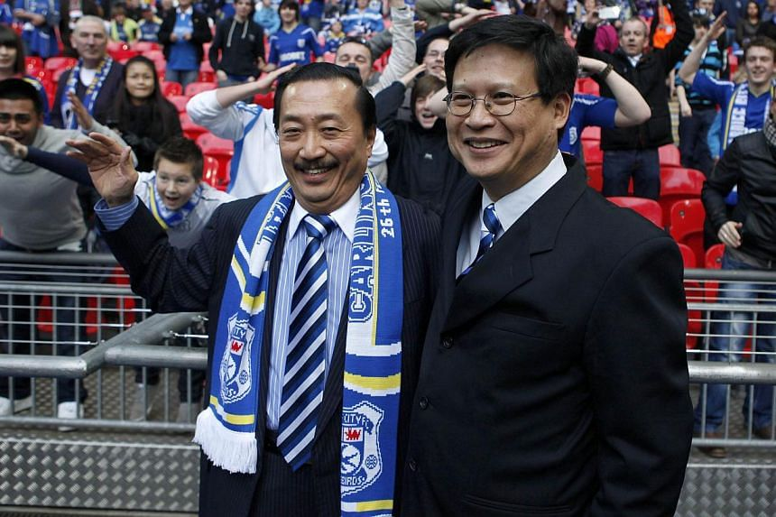 Cardiff City's Malaysian Chairman Chan Tien Ghee (right) and Malaysian owner Vincent Tan smile ahead of their English League Cup final soccer match against Liverpool at Wembley Stadium in London in this Feb 26, 2012 file photo. Tan on Thursday admitt