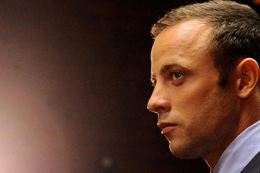Olympic athlete Oscar Pistorius stands in the dock during his bail hearing at the magistrates court in Pretoria, South Africa, on Feb 22, 2013. Pistorius will return to court on Aug 19, when he is expected to be indicted for murdering lover Reeva Ste
