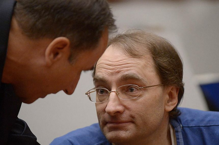 Christian Gerhartsreiter from Germany speaks with his lawyer as he attends his murder trial at Los Angeles Superior. -- PHOTO: AFP
