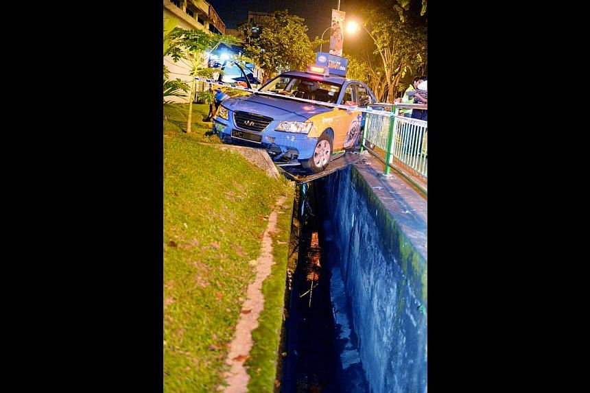 Mr Choo died after his car ploughed through a central divider, skidded across Sin Ming Road and crashed into a drain. -- PHOTO: SHIN MIN