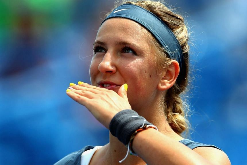 Victoria Azarenka of Belarus celebrates her win against Magdalena Rybarikova of Slovakia during the Western & Southern Open on August 15, 2013 at Lindner Family Tennis Center in Cincinnati, Ohio. As the tennis world buzzed over Marion Bartol
