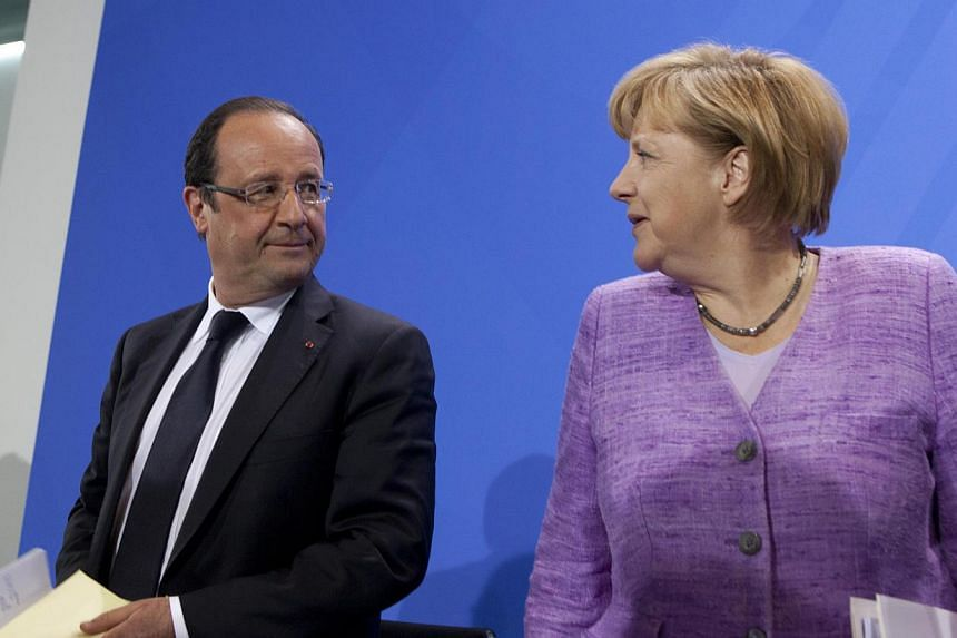French President Francois Hollande and German Chancellor Angela Merkel want European Union foreign ministers to meet next week to discuss the bloc's cooperation with Egypt, Mr Hollande's office said in a statement. --- FILE PHOTO: AP