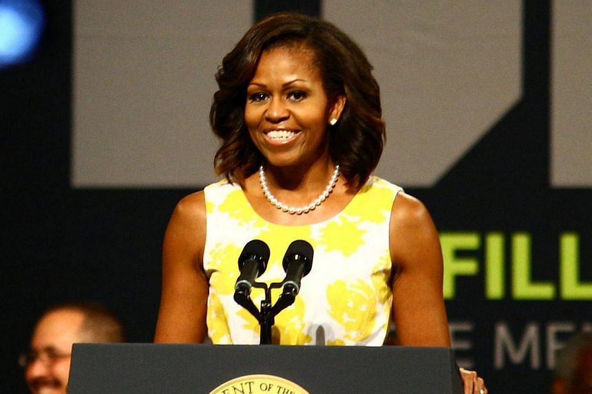 US First Lady Michelle Obama said in remarks published on Friday that America is ready for a woman president, but would not comment on prospects for Mrs Hillary Clinton getting the job. -- FILE PHOTO: AFP
