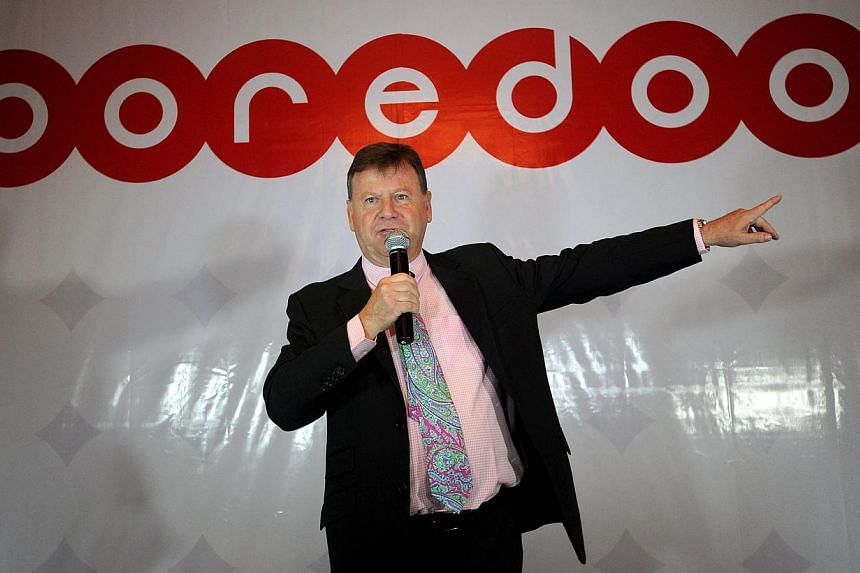 """Mr Ross Cormack, senior representative of Qatari telecom company Ooredoo, talks to the media during a press conference at a hotel in Yangon on Aug 16, 2013. Qatari telecoms giant Ooredoo on Friday pledged to introduce """"affordable"""" phone services to M"""