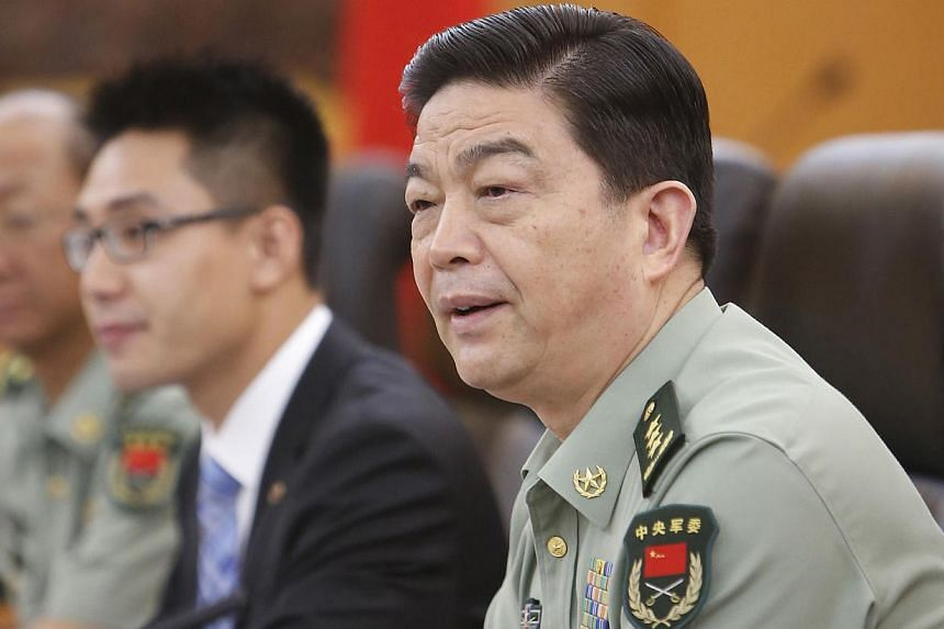 Chinese Defence Minister Chang Wanquan (right) speaks to Swiss Federal President Ueli Maurer (not in picture) during their meeting at the Bayi Building, headquarters of Chinese Defence Ministry in Beijing, China, on July 18, 2013. The Pentagon will h
