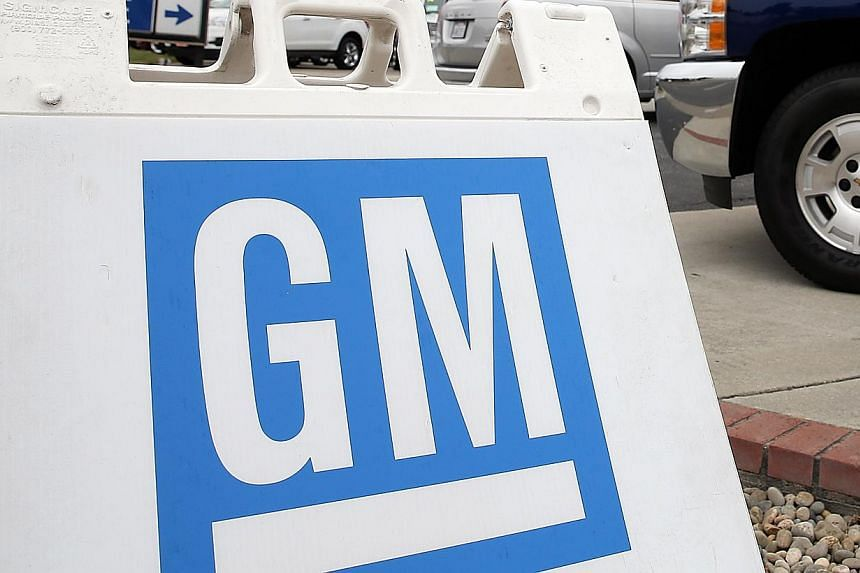 Outside a Chevrolet dealership on July 25, 2013 in Colma, California. GM and Hyundai both recalled large numbers of vehicles in the United States on Friday. -- FILE PHOTO: AFP