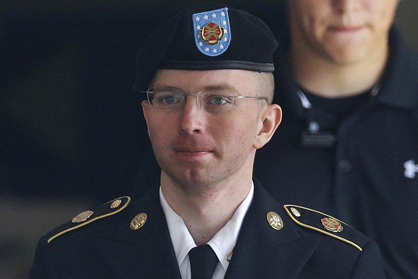 Army Pfc. Bradley Manning is escorted to a security vehicle outside a courthouse in Fort Meade, Md., Friday, Aug. 16, 2013, after a hearing in his court martial. Court is scheduled to reconvene Monday for closing arguments in Manning's sentencing sta