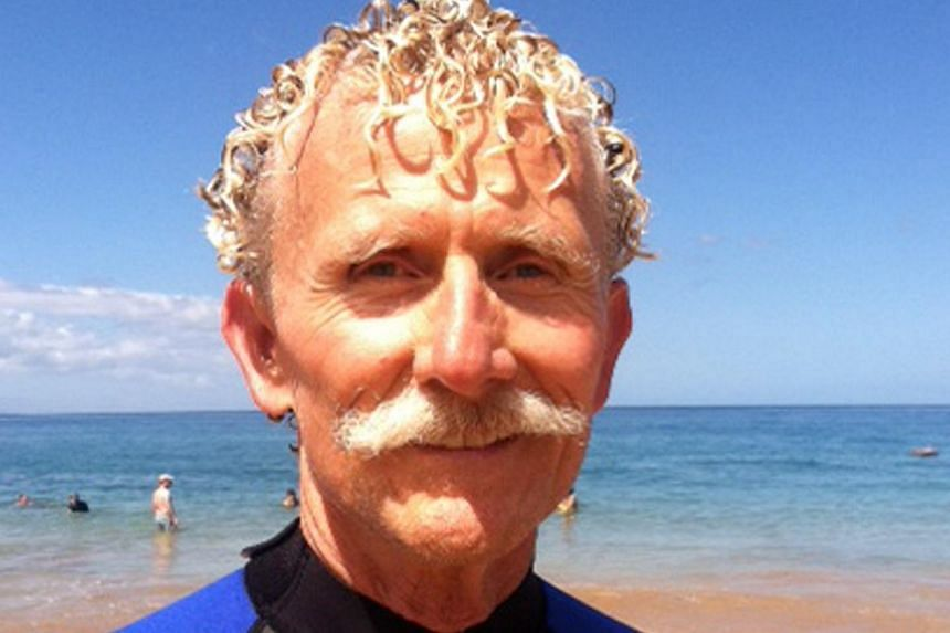 In this Aug 15, 2013 photo provided by Mr Nicholas Grisaffi, Mr Rick Moore poses at Palauea Beach in Makena on the island of Maui, Hawaii, a day after he jumped into the water to rescue a shark attack victim who lost her arm. Mr Grisaffi and other re