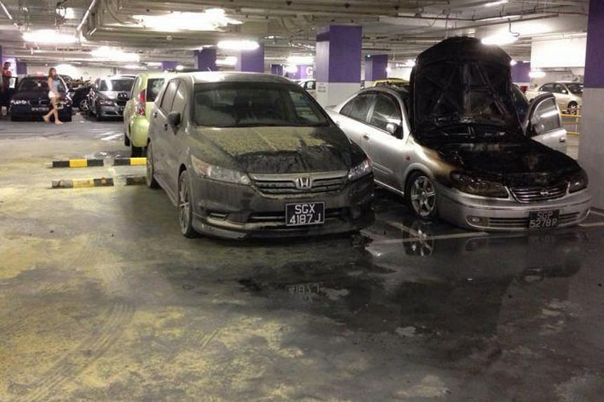 Thousands of shoppers at Jem had to be evacuated on Saturday afternoon at around 2.00pm after a car caught fire in the basement carpark of the mall in Jurong East.-- ST PHOTO: LIM YI HAN