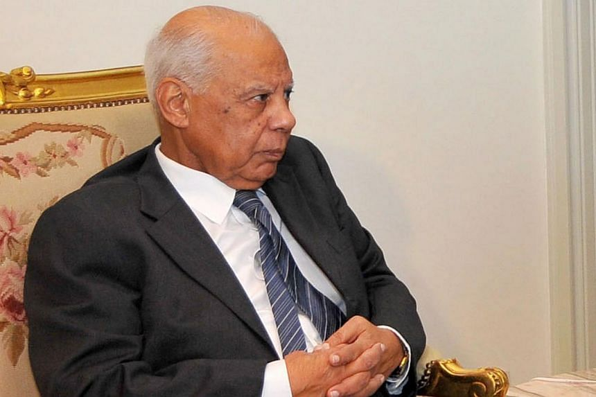 In this Tuesday, July 9, 2013, file photo released by the Egyptian Presidency, Egyptian Prime Minister Hazem el-Beblawi meets with interim President Adly Mansour (not pictured) in Cairo, Egypt. Mr Beblawi has proposed the legal dissolution of th