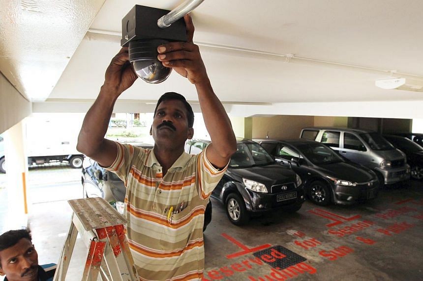A man installs a police camera (Polcam) in a multi-storey carpark. Plans to install Polcams at 650 more blocks of Housing Board flats and multi-storey carparks by the end of the year are on track, said Deputy Prime Minister Teo Chee Hean on Saturday,