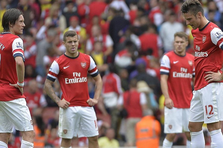Arsenal players (left to right) Tomas Rosicky, Jack Wilshere, Aaron Ramsey and Olivier Giroud react after conceding a third goal to Aston Villa during their English Premier League soccer match at Emirates Stadium in London Aug 17, 2013. -- PHOTO: REU