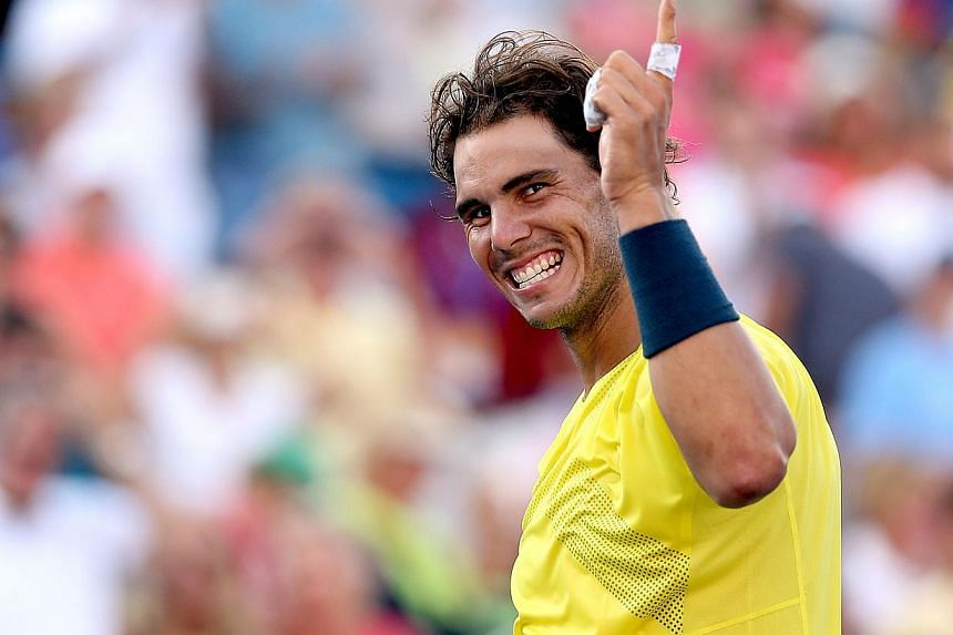 Rafael Nadal of Spain celebrates his win over Tomas Berdych of Czech Republic during the semifinals of the Western & Southern Open on August 17, 2013 at Lindner Family Tennis Center in Cincinnati, Ohio.Spain's Rafael Nadal rolled over sixth