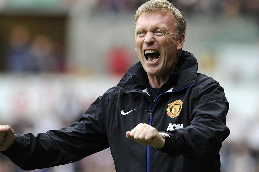 Manchester United's manager David Moyes celebrates his team scoring a goal against Swansea City, during their English Premier League soccer match at Liberty Stadium, Swansea, August 17, 2013. David Moyes praised Manchester United for a clinical perfo