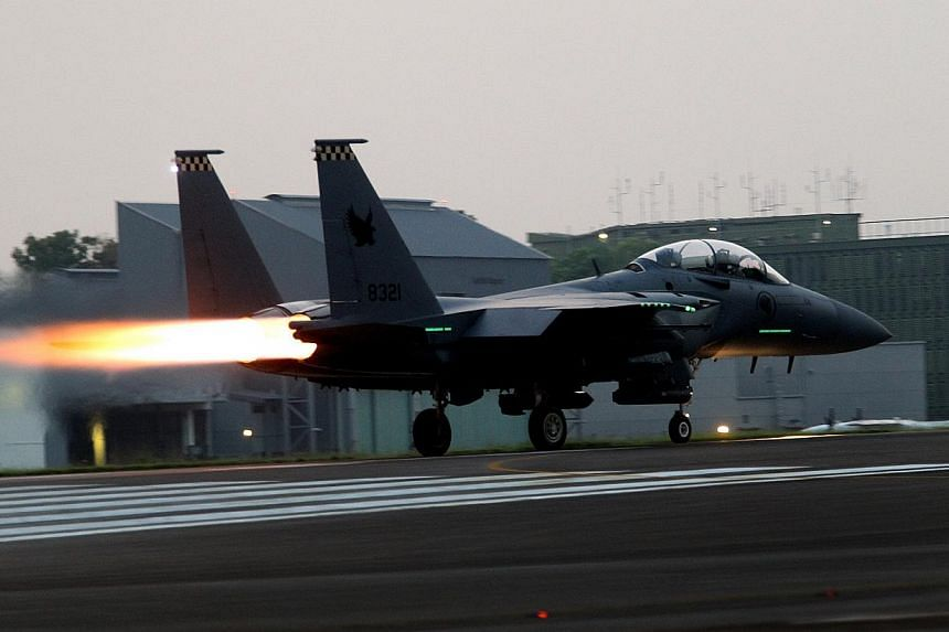 An F-15SG fighter of 149 Squadron rolling down the runway at Paya Lebar Airbase before take-off on June 24, 2013. A new military airbase and a fourth runway will be built at Changi East, Prime Minister Lee Hsien Loong said in his National Day Rally s