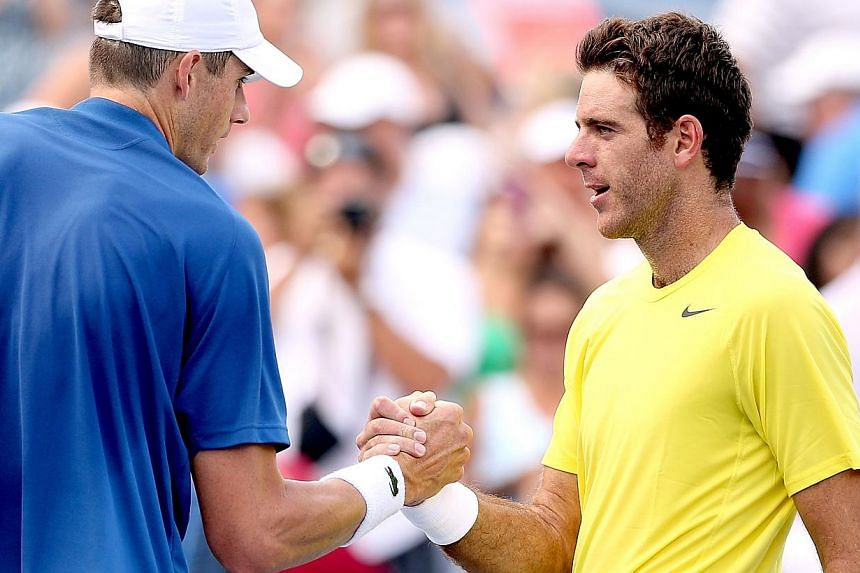 John Isner is congratulated by Juan Martin Del Potro of Argentina after their match during the semifinals of the Western & Southern Open on Aug 17, 2013 at Lindner Family Tennis Center in Cincinnati, Ohio. Juan Martin del Potro double-faulted on