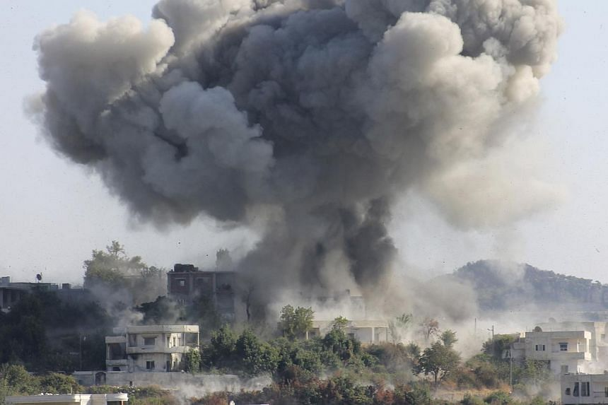 Smoke rises after what activists said was shelling by forces loyal to Syria's President Bashar al-Assad in the village of Dourit, in Latakia countryside on Aug 17, 2013. Fierce fighting raged in Latakia province on Syria's coastline on Sunday, Aug 18