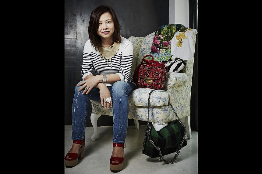 Advertising executive Yeo Ai Ling wearing her online purchases - top by J. Crew from Net-a-porter, necklace and ring by Carrie K Artisan Jewellery from carriekrocks.com. Even with shipping costs, the prices are still lower, she said. -- PHOTO: COURTE