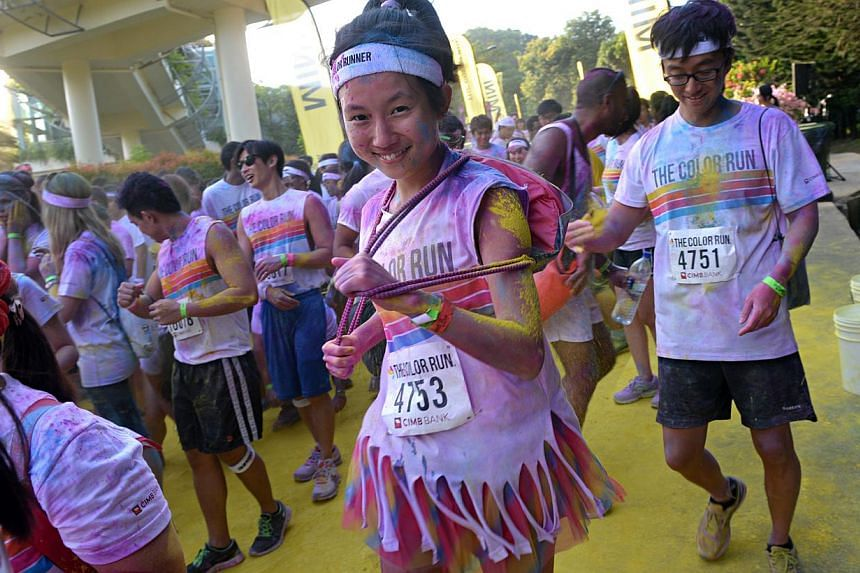 Pictures of reporter Audrey Tan participating in The Color Run at Sentosa. -- ST PHOTO: NURIA LING