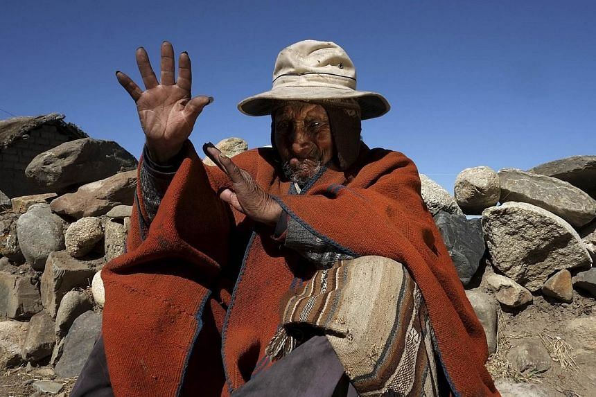 Aymara Indian Carmelo Flores gestures during an interview with Reuters TV in his hometown of Frasquia, 110km north of La Paz on Friday, Aug 16, 2013. Bolivian indigenous farmer Carmelo Flores, who could be the oldest person to have ever lived, attrib