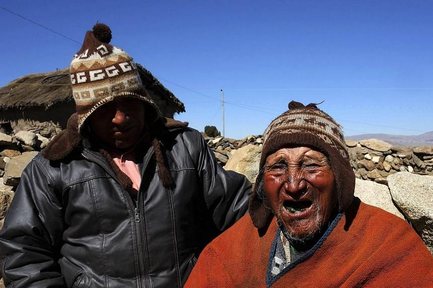 Aymara Indian Carmelo Flores (right) and his son Cecilio joke during a Reuters TV interview in his hometown of Frasquia, 110km north of La Paz on Friday, Aug 16, 2013. Bolivian indigenous farmer Carmelo Flores, who could be the oldest person to have