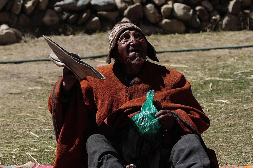 Aymara Indian Carmelo Flores gestures before chewing coca leaves in his hometown of Frasquia, 110km north of La Paz on Friday, Aug 16, 2013. Bolivian indigenous farmer Carmelo Flores, who could be the oldest person to have ever lived, attributes his