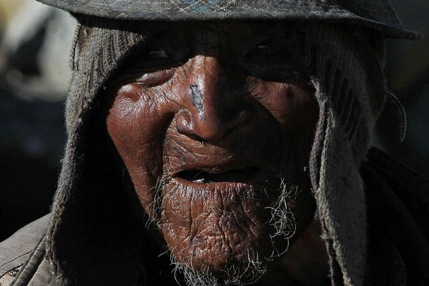 Carmelo Flores Laura, a native Aymara, speaks during an interview outside his home in the village of Frasquia, Bolivia on Tuesday, Aug 13, 2013. Bolivian indigenous farmer Carmelo Flores, who could be the oldest person to have ever lived, attributes