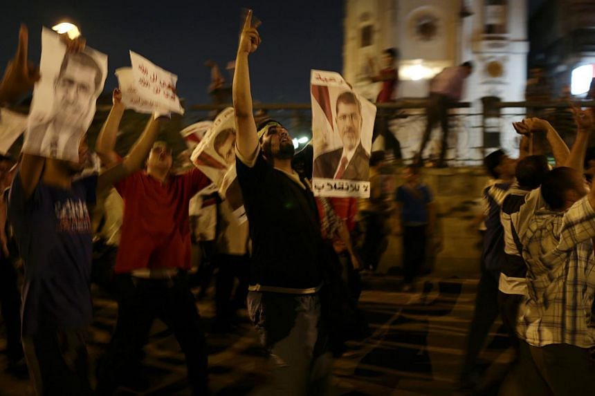 Supporters of Egypt's ousted President Mohammed Mursi chant slogans against Egyptian Defense Minister Gen Abdel-Fattah el-Sissi during a march in Nasr City, where supporters of Egypt's ousted President Mohammed Mursi have installed a camp and hold da