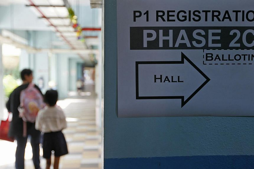 A sign directing parents to the primary one registration phase 2c at South View Primary School on 6 Aug, 2013.Starting from 2014, the Ministry of Education (MOE) will reserve 40 places in every primary school for registrants in phase 2B and 2C,