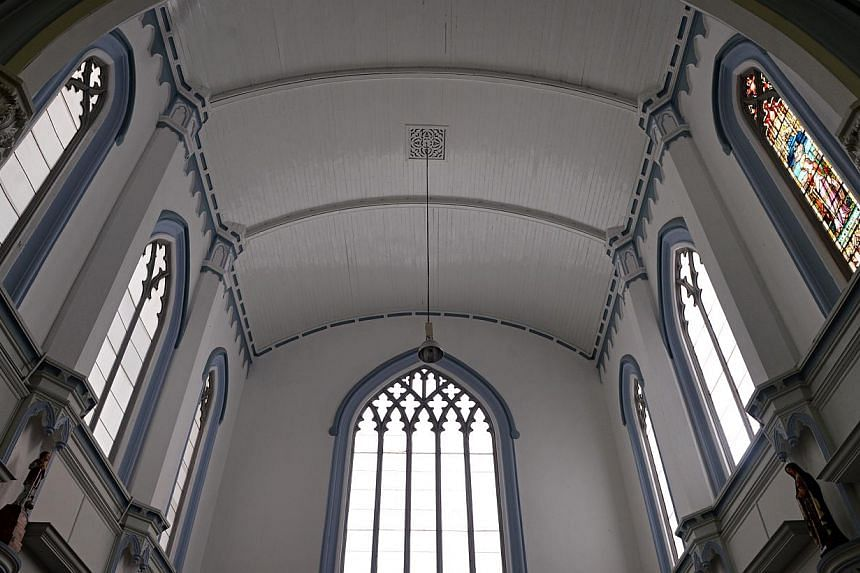Work on St Joseph's Church's restoration began in 2012 but stalled when Reverend Michael Teo refused to allow one window (right), bearing the figure of St Catherine, to be dismantled. The other windows in this section of the church have been remo